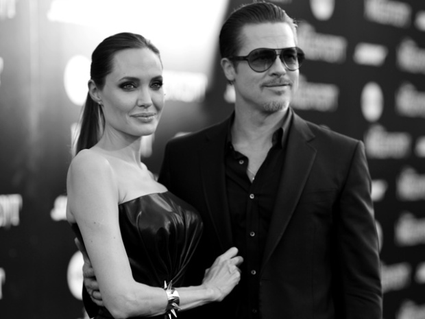 "HOLLYWOOD, CA - MAY 28:  (EDITORS NOTE: Image shot on black and white film. Color version not available.) Actors Angelina Jolie and Brad Pitt attend the World Premiere of Disney's ""Maleficent"", starring Angelina Jolie, at the El Capitan Theatre on May 28, 2014 in Hollywood, California.  (Photo by Charley Gallay/Getty Images for Disney)"
