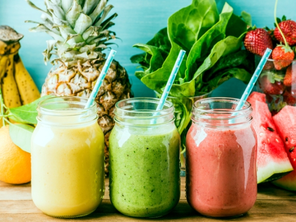 Freshly blended fruit smoothies of various colors and tastes